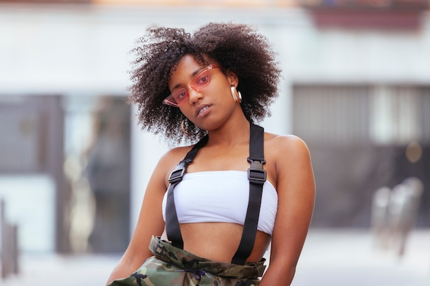 Trendy woman waring military clothes in the street