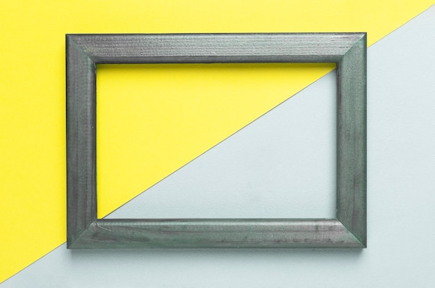 フレームのトレンディな黄色とグレーの色。抽象的な幾何学的な芸術。