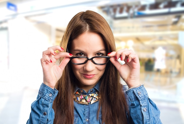 Trendy young woman wearing black glasses