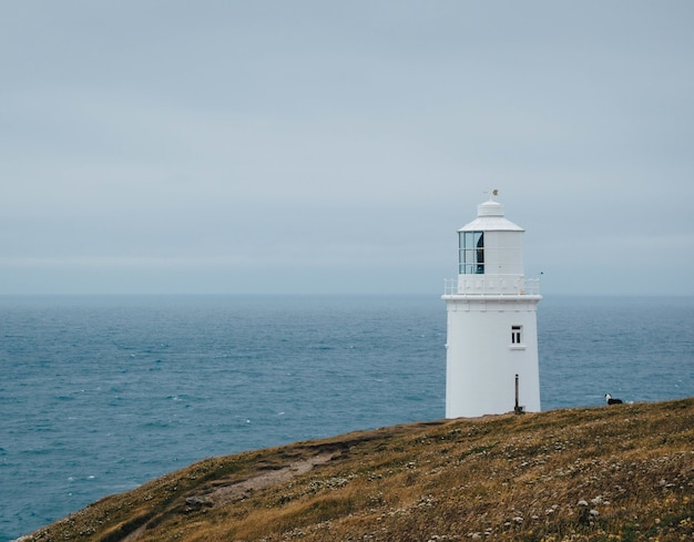 Trevose head lighthouse in england with a beautiful view of an ocean