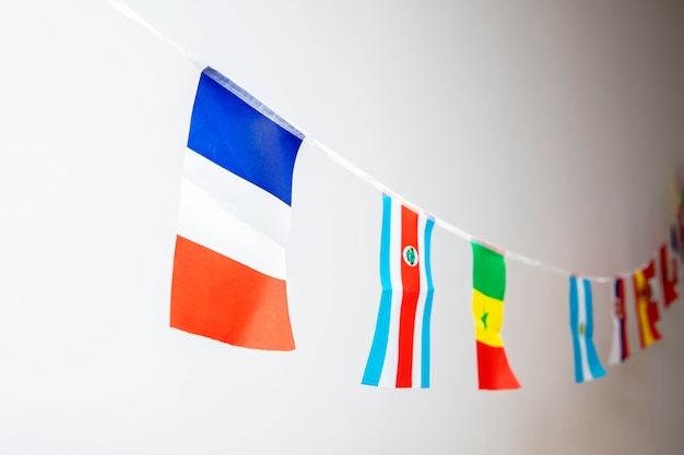 Triangle flags of various countries hanging on the rope