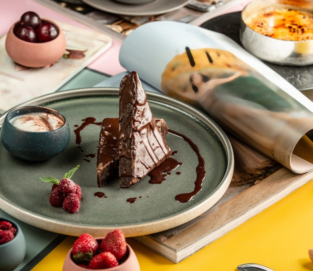 Triangle shaped chocolate brownies served with ice cream