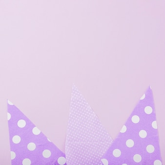 Triangular paper shapes on plain background