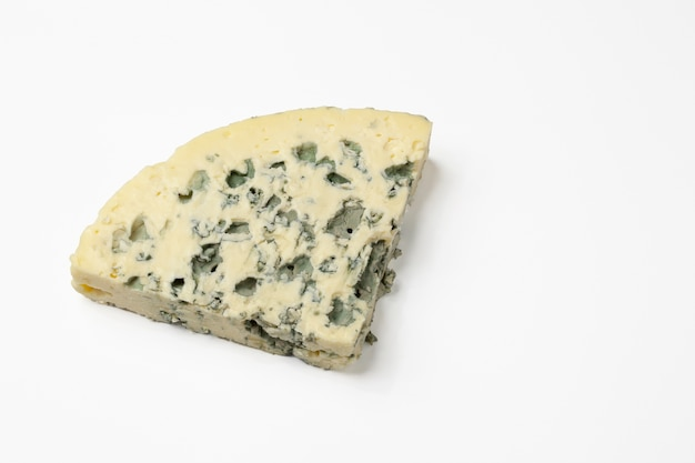 Triangular piece of blue cheese. isolated on a white surface.