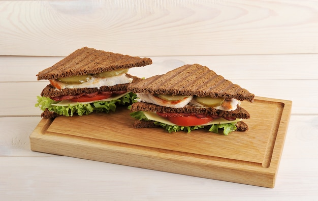Triangular sandwich on a wooden board