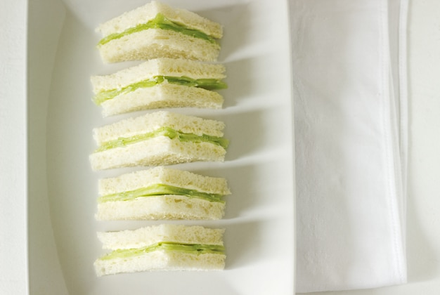 Triangular sandwiches with cucumber and butter for a tea party
