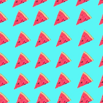 Triangular slices of watermelon in row on blue background