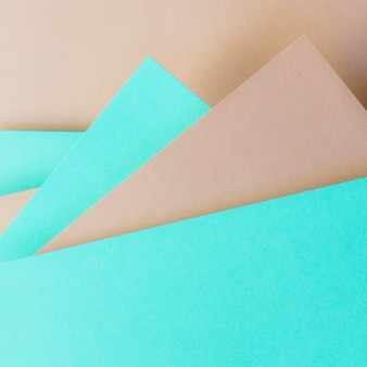 Triangular turquoise and brown paper background for banner