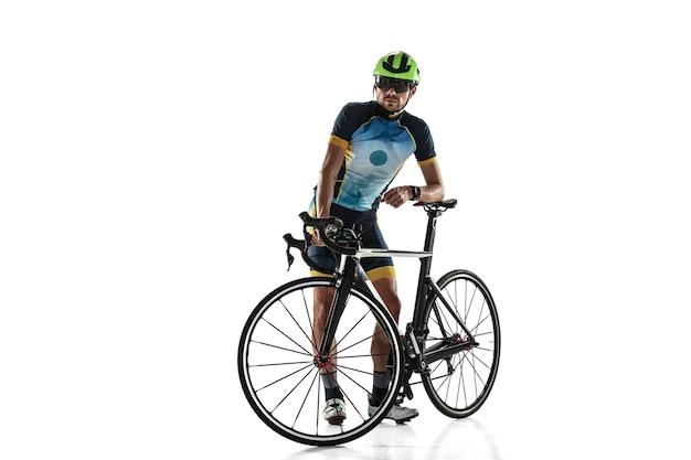 Triathlon male athlete cycle training isolated on white studio background