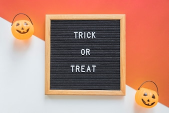 Trick or treat baskets near frame with writing