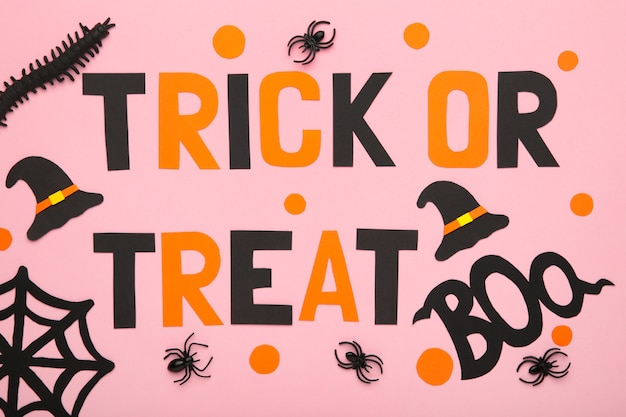 Trick or treat background on beige. halloween concept. top view