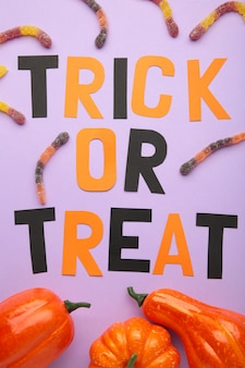 Trick or treat background on blue. halloween concept. top view. vertical photo