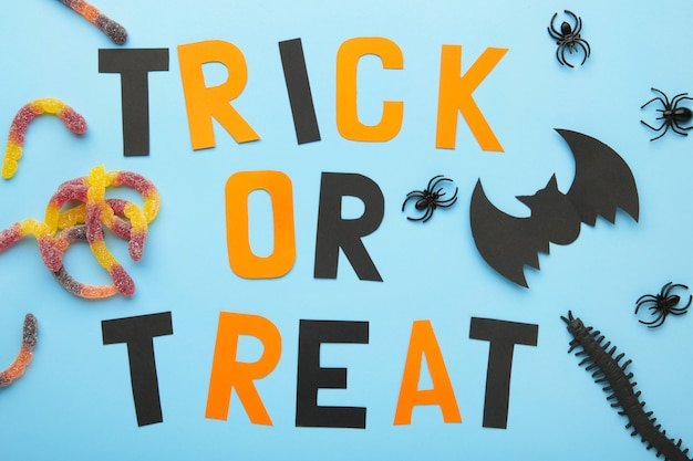 Trick or treat background on blue. halloween concept. top view