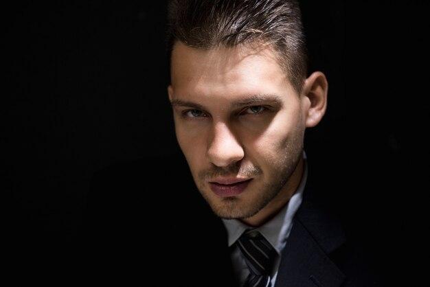 Tricky sly man face in dark room