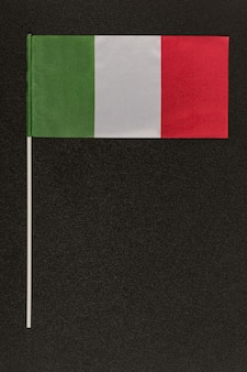 Tricolor italian flag green white red on black background Premium Photo