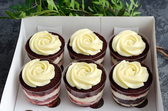 Trifle red velvet with cream in a gift box.