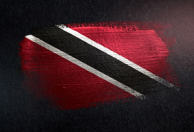 Trinidad and tobago flag made of metallic brush paint on grunge dark wall