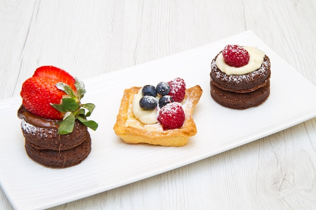 Trio of cakes with fruit