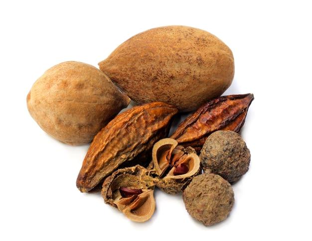 Triphala-a combination of ayurvedic fruits on white background