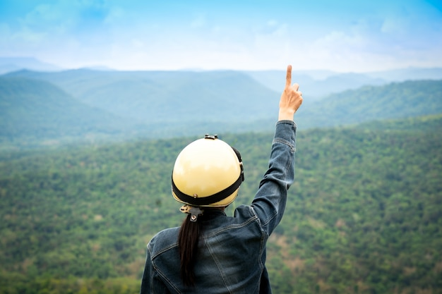 Trips travel freedom in the world, index finger of tourist is first on sky and cloud