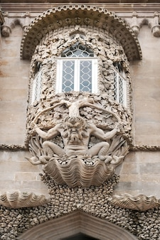 Triton over the entrance, pena national palace, in sintra portugal