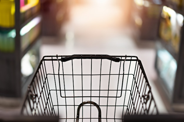 Trolley cart on abstract supermarket