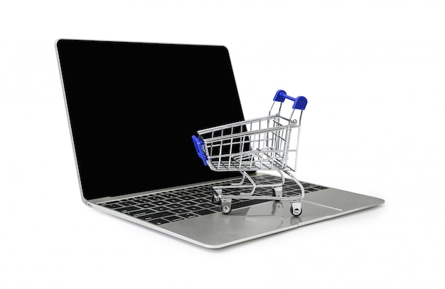 A trolley on a laptop keyboard on white  background with clipping path