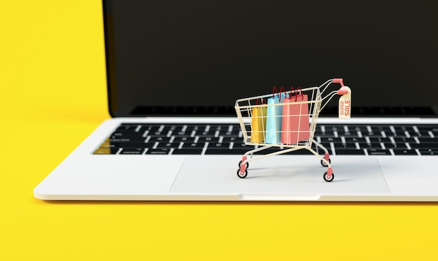 A trolley on top of a laptop computer for online shopping concept, e-commerce business and marketing background