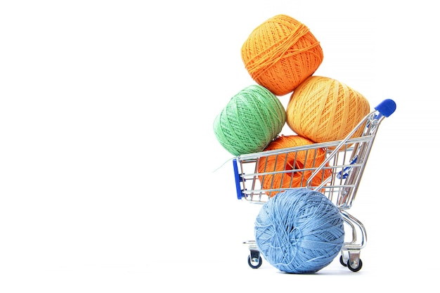 Trolley with yarn for knitting.