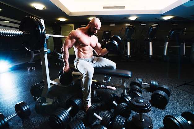 Trong man lifting dumbbells