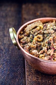 Tropeiro beans, brazilian food, made from beans, chopped pepperoni sausage, farofa and pepper