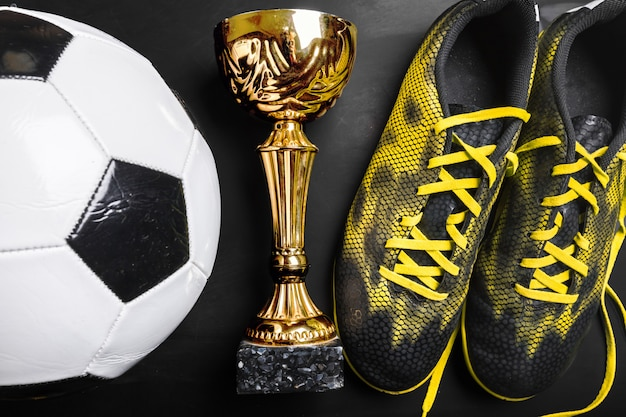 Trophy cup and soccer ball
