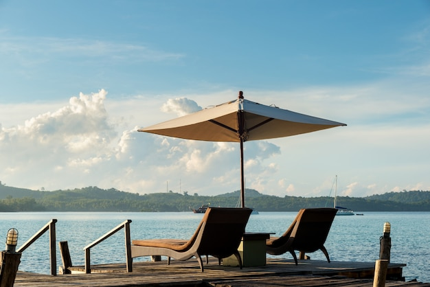 Tropical beach resort with lounge chairs and umbrellas in phuket ,thailand.