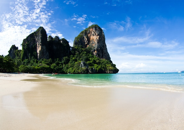 Tropical beach with big mountain on the shore