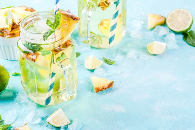 Tropical drink,  pineapple mojito or lemonade with fresh lime and mint