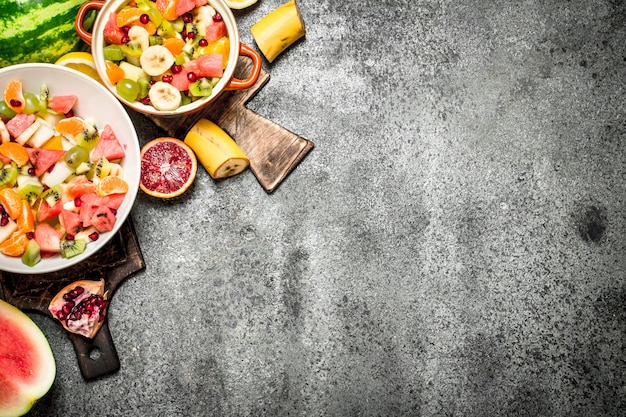 Tropical food . a tropical fruit salad. on rustic background.