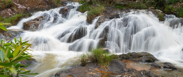 Tropical forest waterfall, panoramic shot, long exposure
