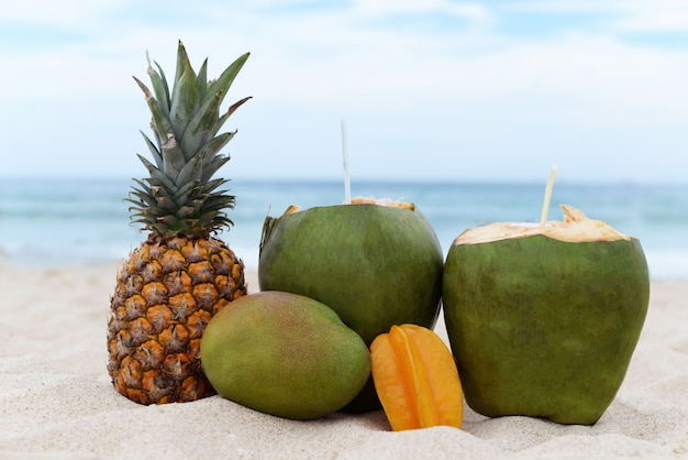 Tropical fruit green coconut young with anannas carom and mango on holiday
