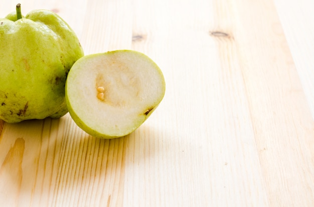 The tropical fruit high vitamin c, fresh guavas on wood background
