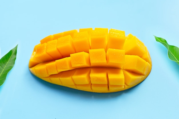 Tropical fruit, mango on blue table. top view