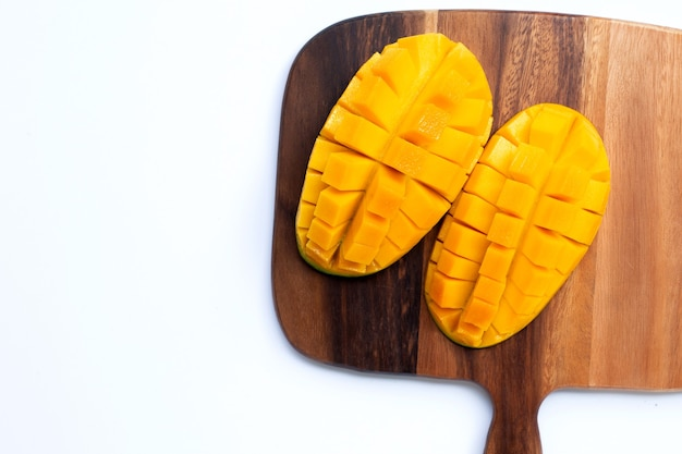 Tropical fruit, mango on  cutting board on white background. top view