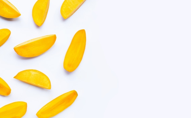 Tropical fruit, mango slices on white background. top view