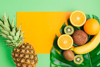 Tropical fruits background with card template and pineapple