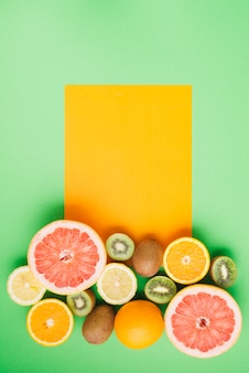 Tropical fruits background with card template