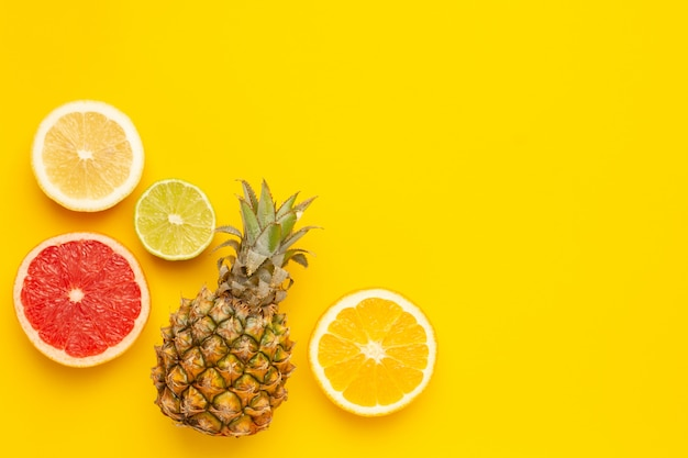 Tropical fruits pineapple, orange and lime