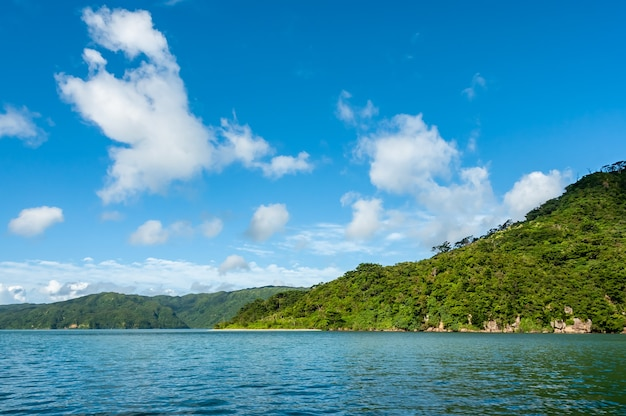 Tropical green mountains blue sky clouds seen from sea