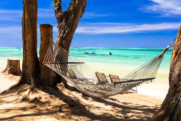 Tropical holidays - relax in hammock on the beach