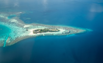 Tropical islands and atolls in Maldives from aerial view.