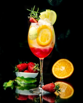 Tropical juice with multiple sliced fruits