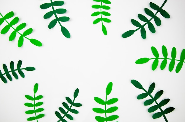 Tropical leaves in paper cut style green frame
